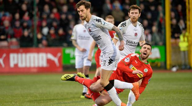 Derby fever: Declan Caddell taking on Cliftonville in the festive fixture last year