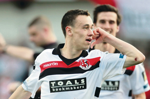 Breakthrough goal: Paul Heatley celebrates Crusaders' opener in the north Belfast derby at Solitude