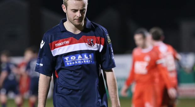 Lost ground: Crusaders ace Richard Clarke trudges off after defeat to Portadown on Tuesday
