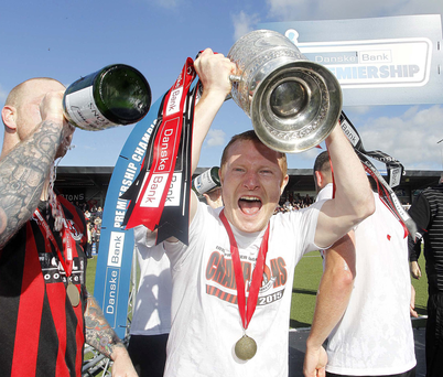 Party time: David Magowan shows his delight at getting to grips with the Gibson Cup
