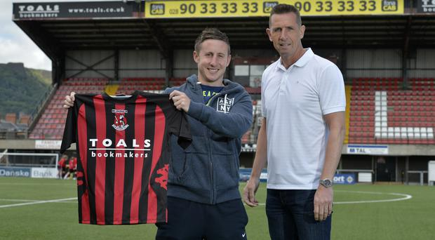Different surroundings: New Crusaders signing Michael Carvill checks out Seaview with boss Stephen Baxter