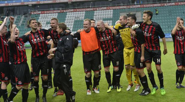 Hitting the jackpot: Crusaders players celebrate after the 1-1 draw in Tallinn which secured their progress in the Champions League qualifying rounds