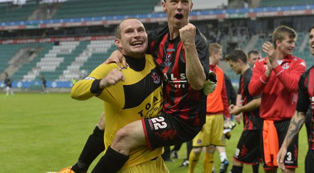 Winning Crue: Paul Heatley and Crusaders keeper team-mate Sean O'Neill will look to repeat this scene of celebration from Estonia last week in Albania tonight