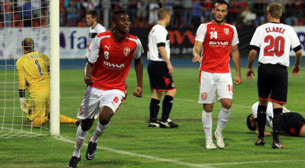 Take that: Skenderbeu's Bakary Nimaga celebrates his goal against Crusaders