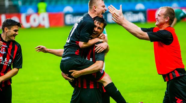 Mission improbable: Crusaders players Andrew Mitchell, Declan Caddell and Jordan Owens get the party started after the sensational win over Levadia Tallinn