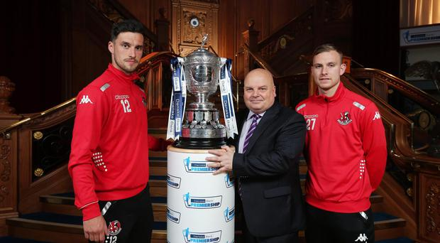 Title tilt: Eddie Taylor from Danske Bank is joined by Crusaders duo Declan Caddell and Andy Mitchell at the launch of the Danske Bank Premiership