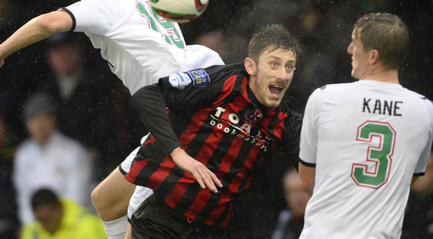 High jinx: Glentoran's Johnny Addis and Jordan Forsythe of Crusaders challenge for the ball