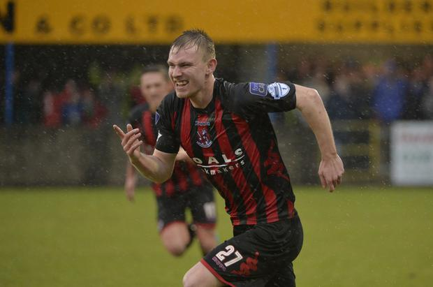 Glory hunter: Andrew Mitchell celebrates his goal for Crusaders in the sixth round victory over Dungannon Swifts