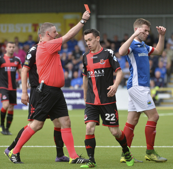 Marching orders: Stephen Lowry of Linfield sees red after a second yellow card