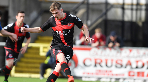 Composed: Gavin Whyte scores Crusaders' equaliser from the penalty spot