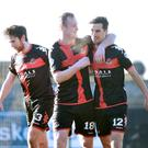 Match-winner: Declan Caddell (right) is congratulated after scoring the only goal of the game for Crusaders