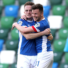 Title shot: Aaron Burns celebrates with Niall Quinn after firing Linfield back into Gibson Cup contention