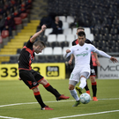 On target: Crusaders ace Michael Carvill finds the back of the FK Liepaja net at Seaview last night