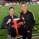 New surroundings: Sean Ward at Seaview with Crusaders manager Stephen Baxter after parting company with champions Linfield