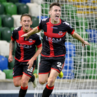 Crues control: Gavin Whyte sets off in celebration after hitting Crusaders' third on a miserable night for David Healy