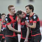 Star man: Gavin Whyte (centre) takes the praise after scoring