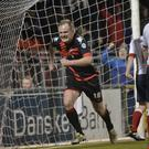 Late winner: Jordan Owens celebrates his stoppage time goal