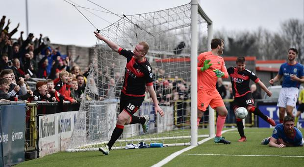 Brace bagged: Jordan Owens celebrates his second goal and is confident Crusaders can win title