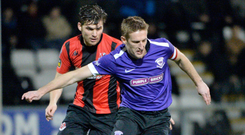 Big changes: Jeff Hughes and Martin Donnelly have been two of the high-profile arrivals that Larne's growing fanbase have grown accustomed to watching, which Crusaders boss Stephen Baxter says is good for Irish League football