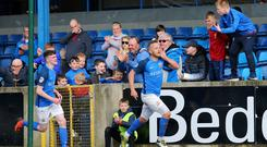 Listen up: Sammy Clingan, complete with odd boots, celebrates his late winner