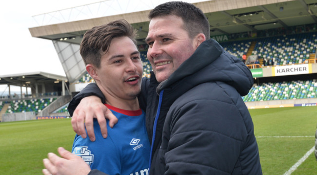 Winning feeling: Jordan Stewart celebrates with Linfield manager David Healy