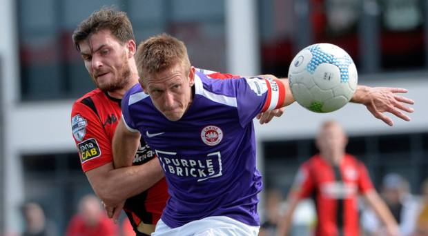 Battle stations: Philip Lowry grapples with Jeff Hughes of Larne