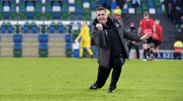 Relishing it: Crusaders boss Stephen Baxter celebrates a win over Linfield earlier this year