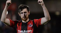Big win: Crusaders defender Howard Beverland celebrates the victory over Linfield at Seaview