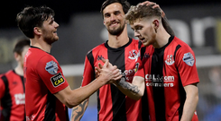 Goal hungry: Jamie McGonigle is congratulated after scoring in Crusaders' rout at Dungannon