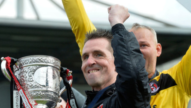 Just champion: Crues boss Stephen Baxter celebrates with the league title, but it hasn't always been so rosy for the club