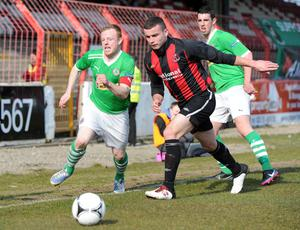 Derby day: Cliftonville midfielder George McMullan tries to get past Crusaders defender Colin Coates