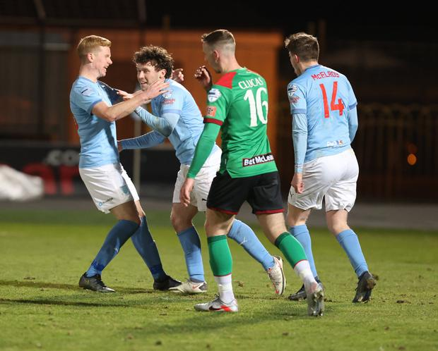 Two good: Shay McCartan celebrates after the first of his brace against Glentoran