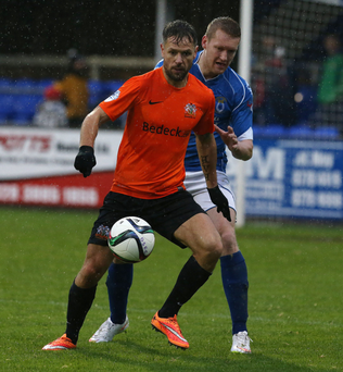 Tussle: Glenavon's Declan O'Brien and David Armstrong