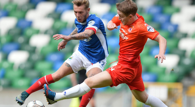 Round the twist: Kirk Millar attempts to steer past Dungannon's Ally Teggart