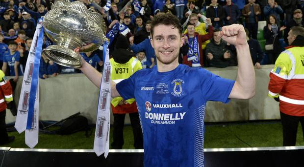 Super Swift: Two-goal hero Ryan Mayse with the trophy