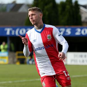 Double joy: Kirk Millar celebrates his second goal of the game at Stangmore Park
