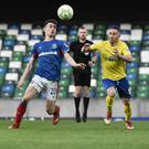 Eyes forward: Dungannon's Michael Carvill closes in on Stephen Fallon