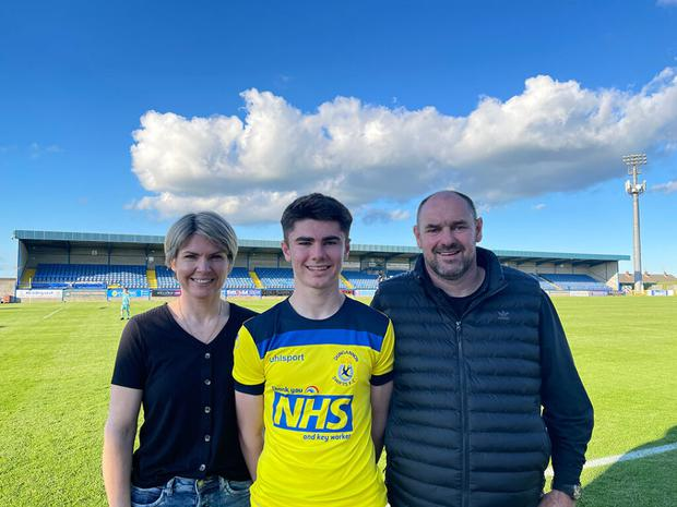 Darren Robinson with his proud parents Zelda and Malcolm after his Dungannon debut on Saturday. Pic: Dungannon Swifts