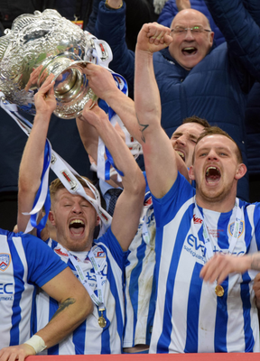 Double act: Lyndon Kane and Aaron Canning with the League Cup