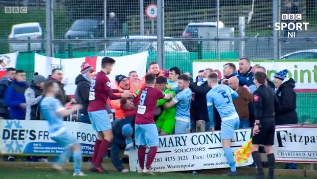 Ugly scenes: Warrenpoint goalkeeper Mark Byrne clashed with Ballymena supporters on Saturday