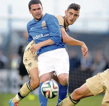 Star quality: Glenavon's guest star David Healy finds himself closely monitored by Leeds defender Jake Skelton during last night's game at Mourneview Park