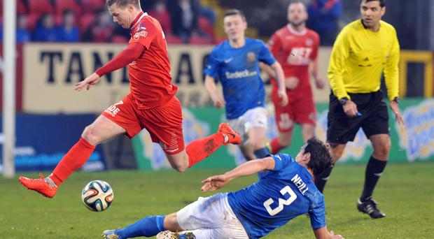 Incoming: Glenavon's Kyle Neill slides in on Portadown winger Peter McMahon during Saturday's derby duel at Shamrock Park