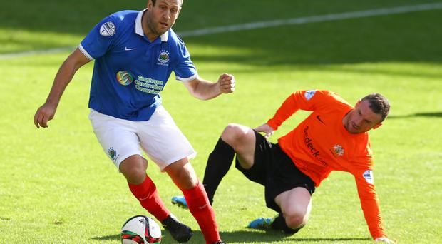 Guy Bates skips away from former Glenavon team-mate Andy Kilmartin
