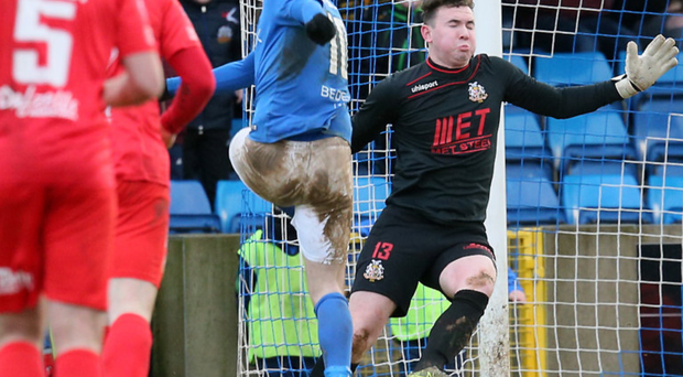 Damage done: Eoin Bradley slots in the third goal