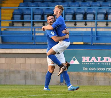Joy: Eoin Bradley and Mark Sykes celebrate David McAllister's own goal