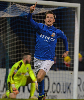 Spot on: Glenavon's Andy McGrory scores from the penalty spot in extra time to make it 3-1 last night
