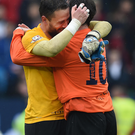 Special moment: Emotional Glenavon keeper Jonny Tuffey embraces boss Gary Hamilton after success in last season's Irish Cup final