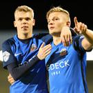 Job done: Andy Mitchell is congratulated by Rhys Marshall after sealing Glenavon's win with a late goal at Mourneview