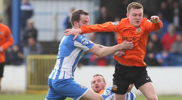 Crunch clash: Glenavon's James Singleton grapples with Coleraine's David Kee at the end of last season. The league's in-form sides meet in a top-of-the-table tie at Mourneview Park tomorrow