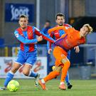Centre of attention: Mark Sykes battles with Ards' Kyle Cherry
